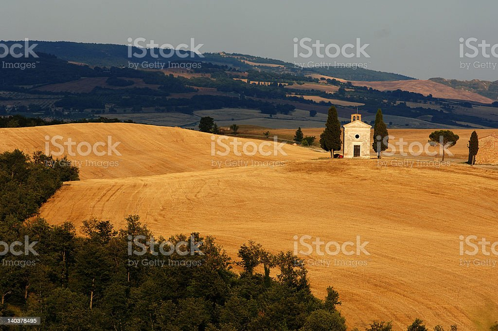 little church on the hill in summer tuscany royalty-free stock photo