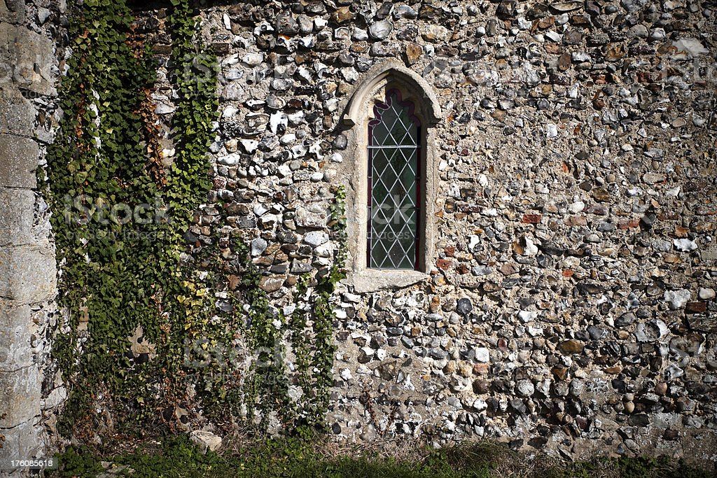 Little church window and exterior wall stock photo