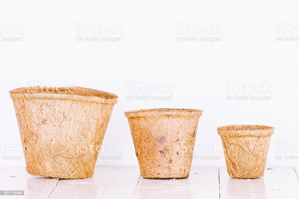 Little clay flower pots on wooden table stock photo