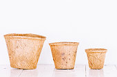 Little clay flower pots on wooden table