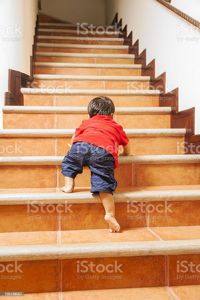 Little climber, toddler, climbing, stairs. royalty-free stock photo