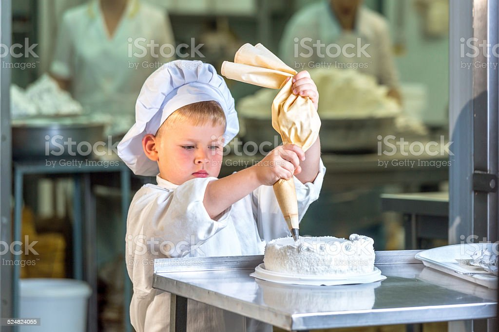 Little confectioner assistant stock photo
