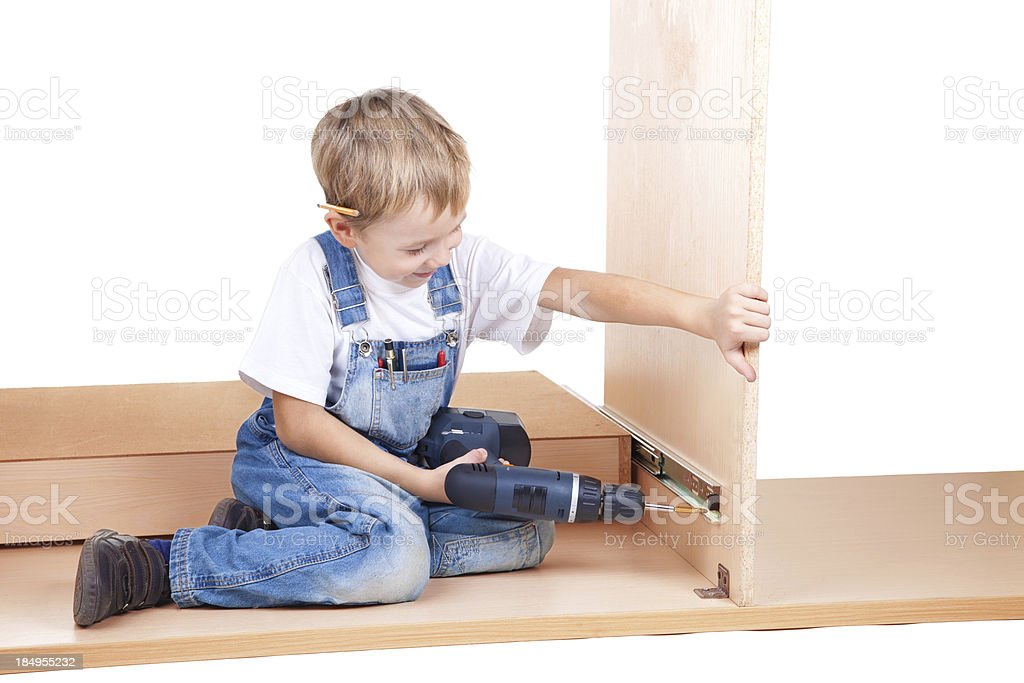 Little construction boy use electric screwdriver royalty-free stock photo