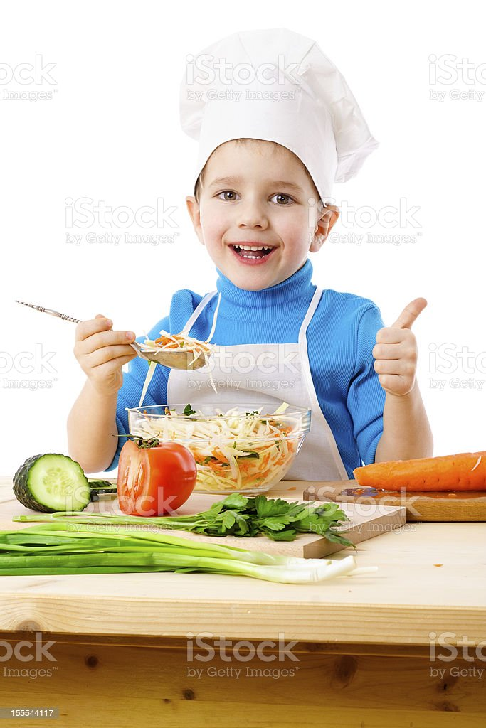 Little cook tasting salad royalty-free stock photo