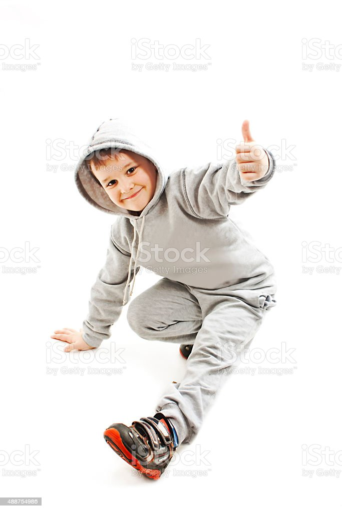 Little cool hip-hop boy in dance showing ok sign stock photo