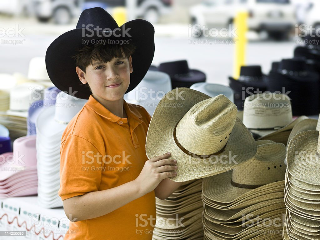 Little cowboy at a Hat Shop royalty-free stock photo