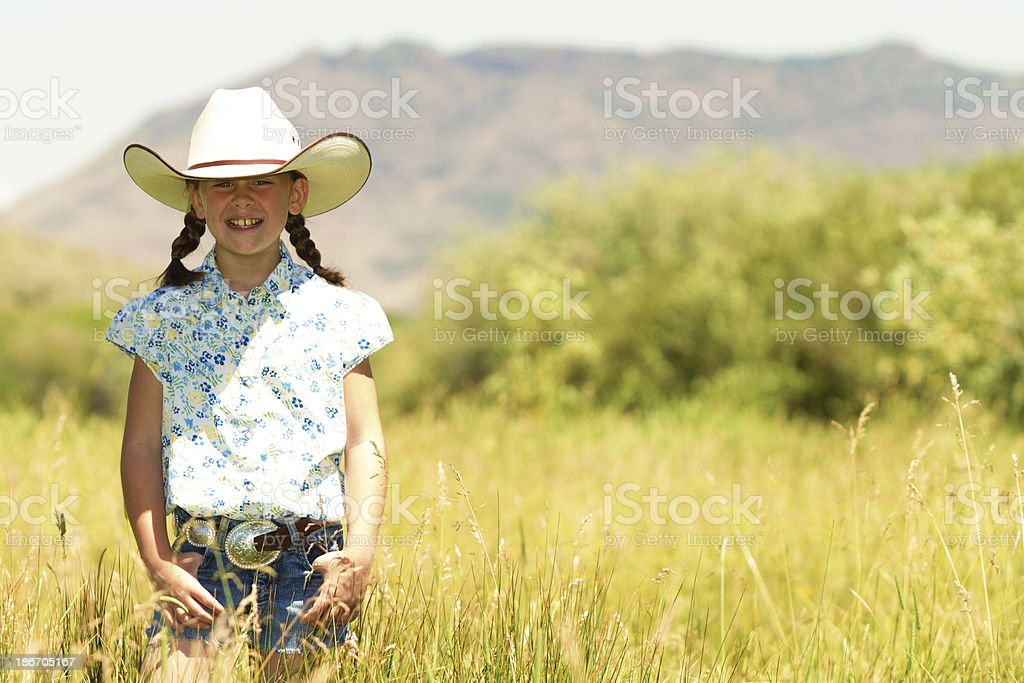 Little cowgirl in meadow royalty-free stock photo