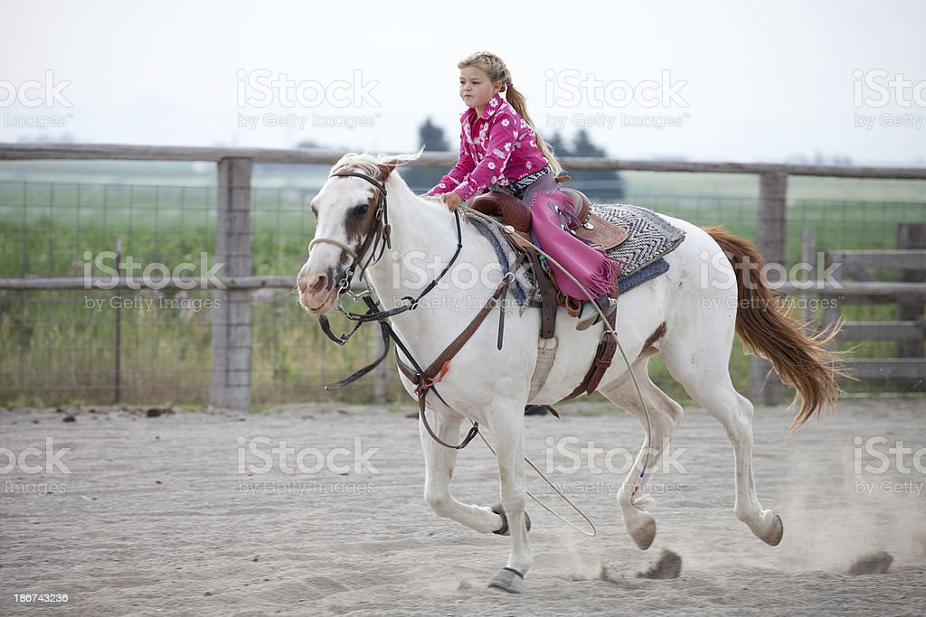 Little Cowgirl Wearing Pink Riding Horse royalty-free stock photo