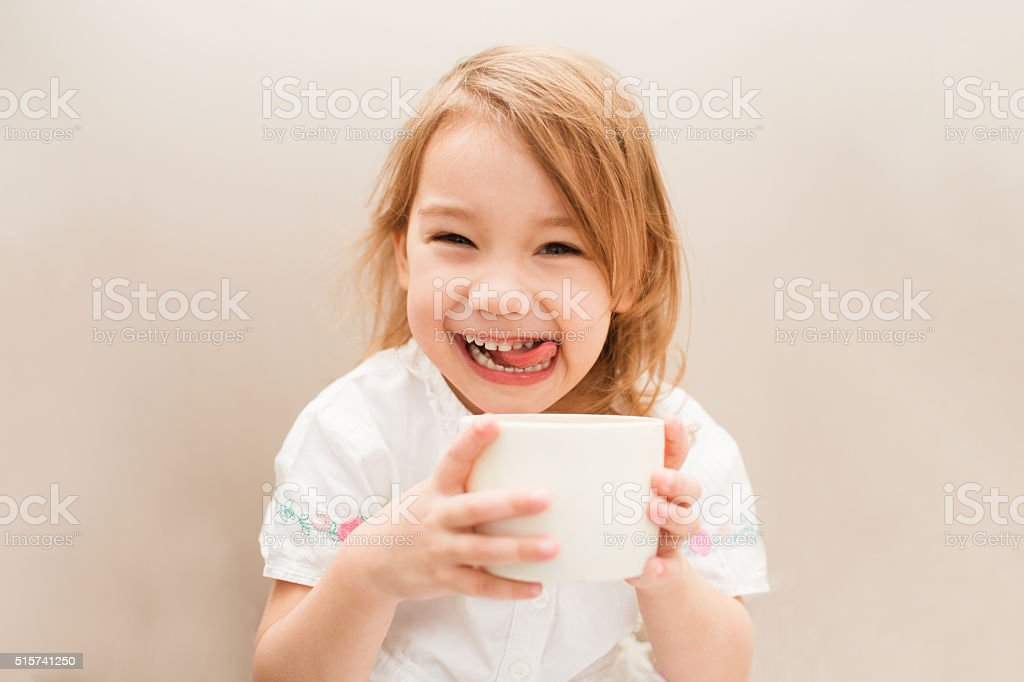 Little cute and sweet girl with tea stock photo