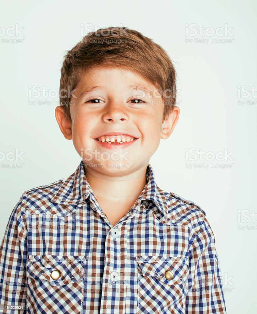 little cute boy on white background gesture stock photo