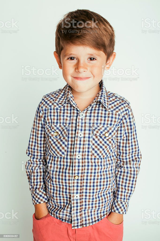 little cute boy on white background gesture smiling close up stock photo