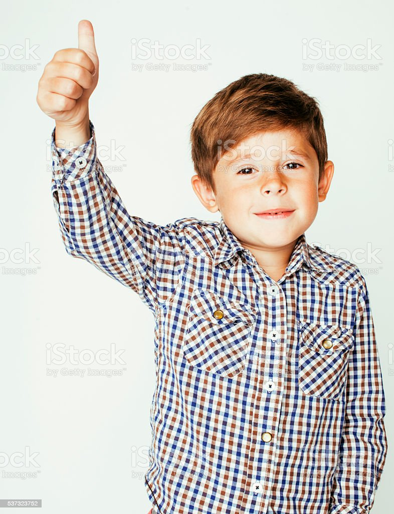 little cute boy on white background gesture smiling closeup, thumbs stock photo