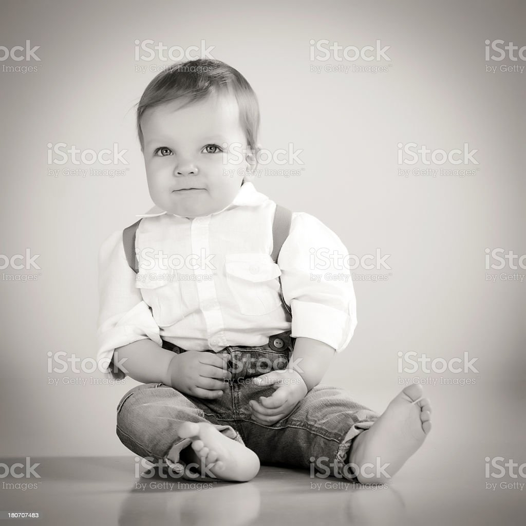 Little cute boy sitting royalty-free stock photo