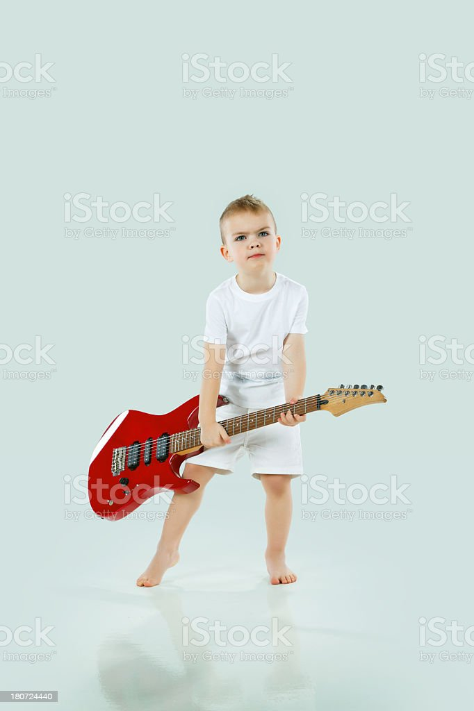 Little cute boy with an electric guitar royalty-free stock photo