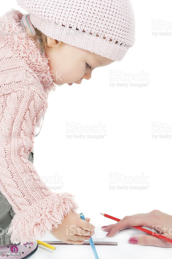 Little cute girl being tought by mother stock photo