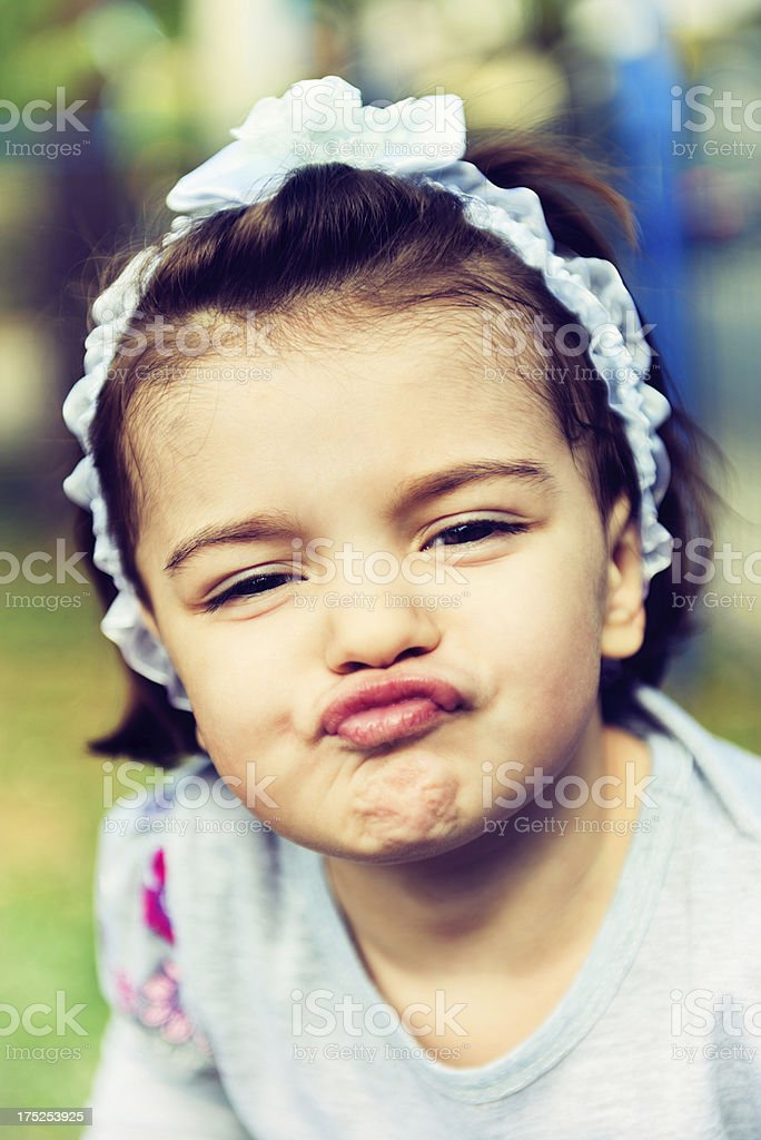 Little Cute Girl Blowing Kisses royalty-free stock photo