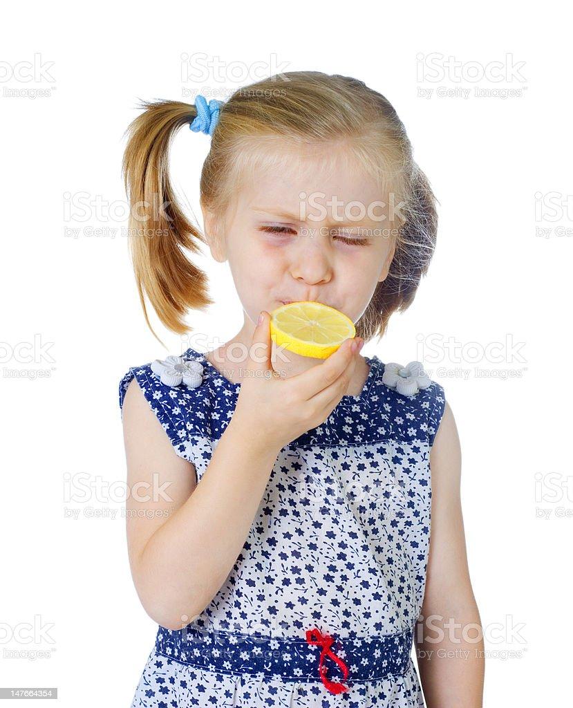 little cute girl eating fresh lemon royalty-free stock photo