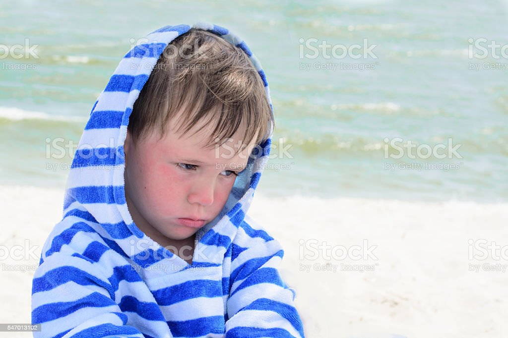 Little cute kid hurt and pouted, disappointed stock photo