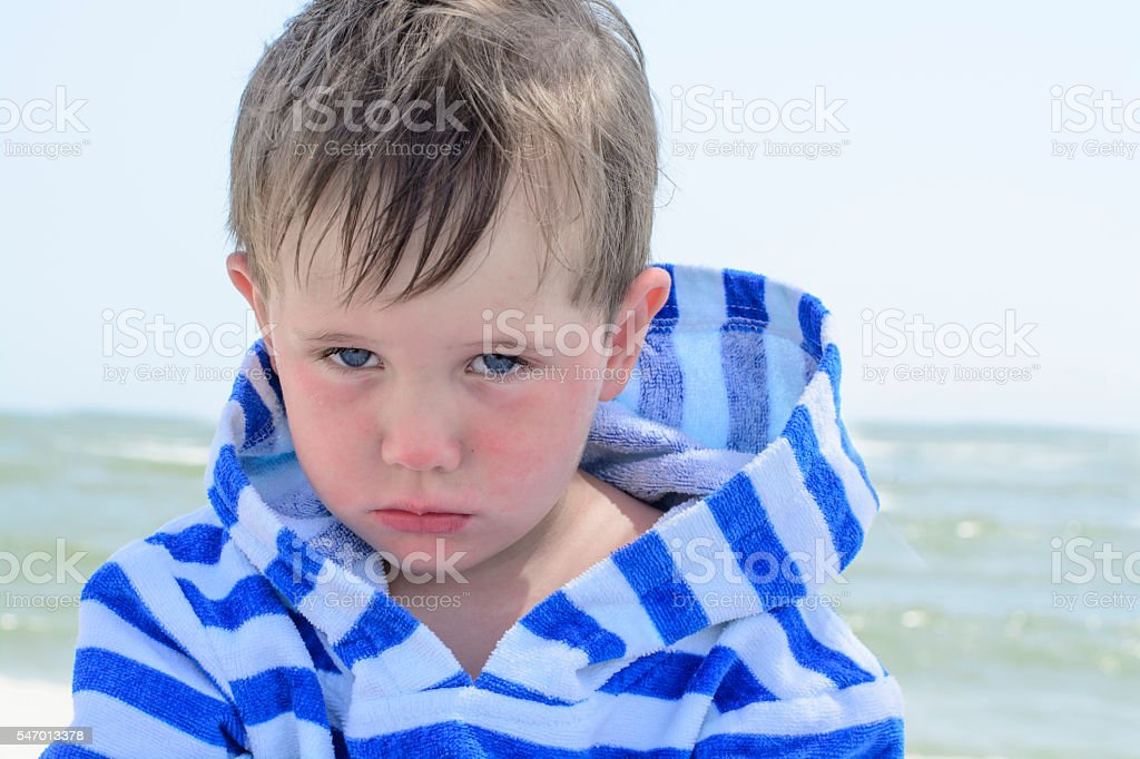 Little cute kid hurt and pouted, disappointed. stock photo