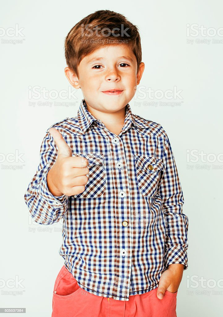 little cute real boy on white background gesture smiling close stock photo