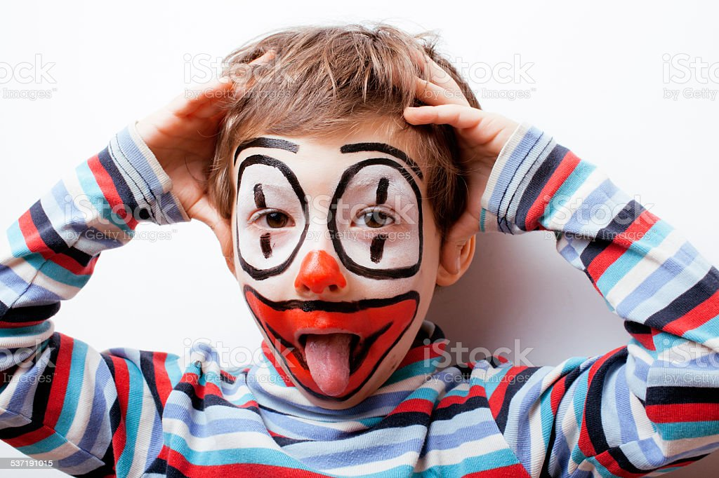 little cute real boy with facepaint like clown, pantomimic expre stock photo