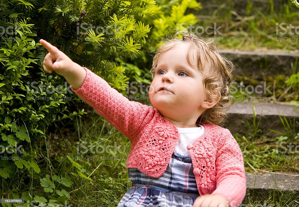 Little cute small child showing us something royalty-free stock photo