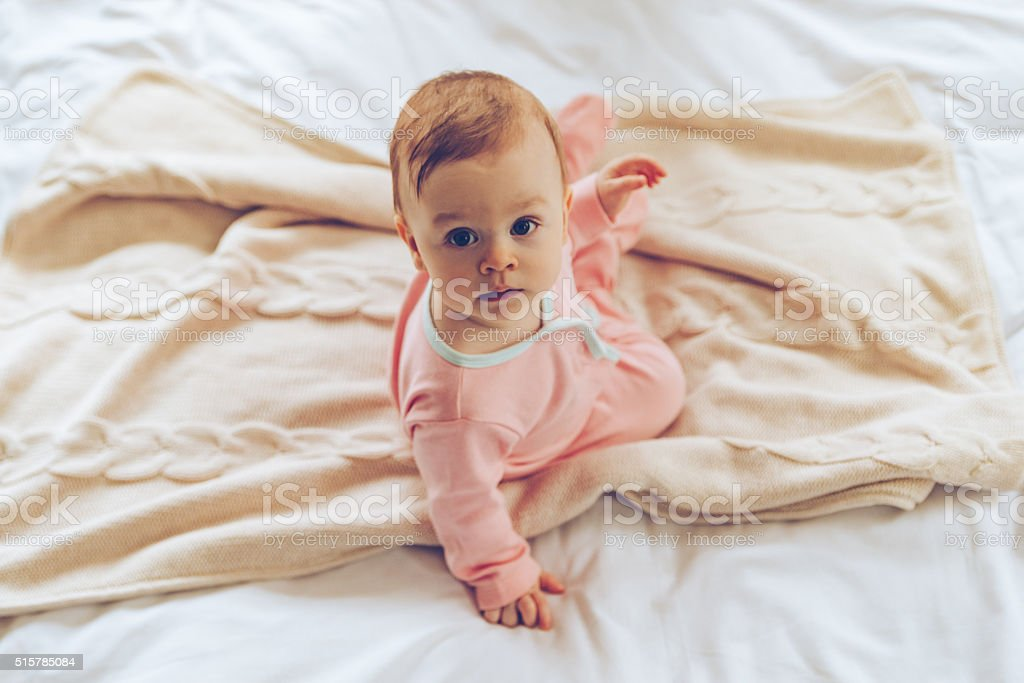 Little cutie in bed. stock photo