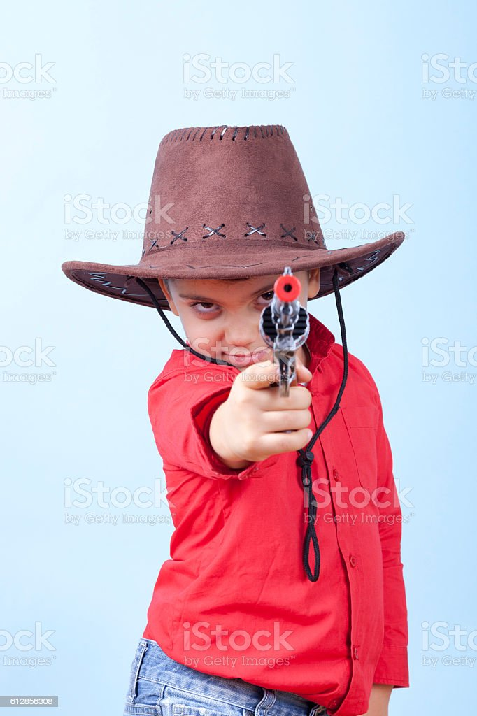 Little Dangerous Cowboy is Pointing His Toy Gun stock photo