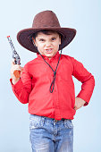 Little Dangerous Cowboy is Threatening Us With His Toy Gun