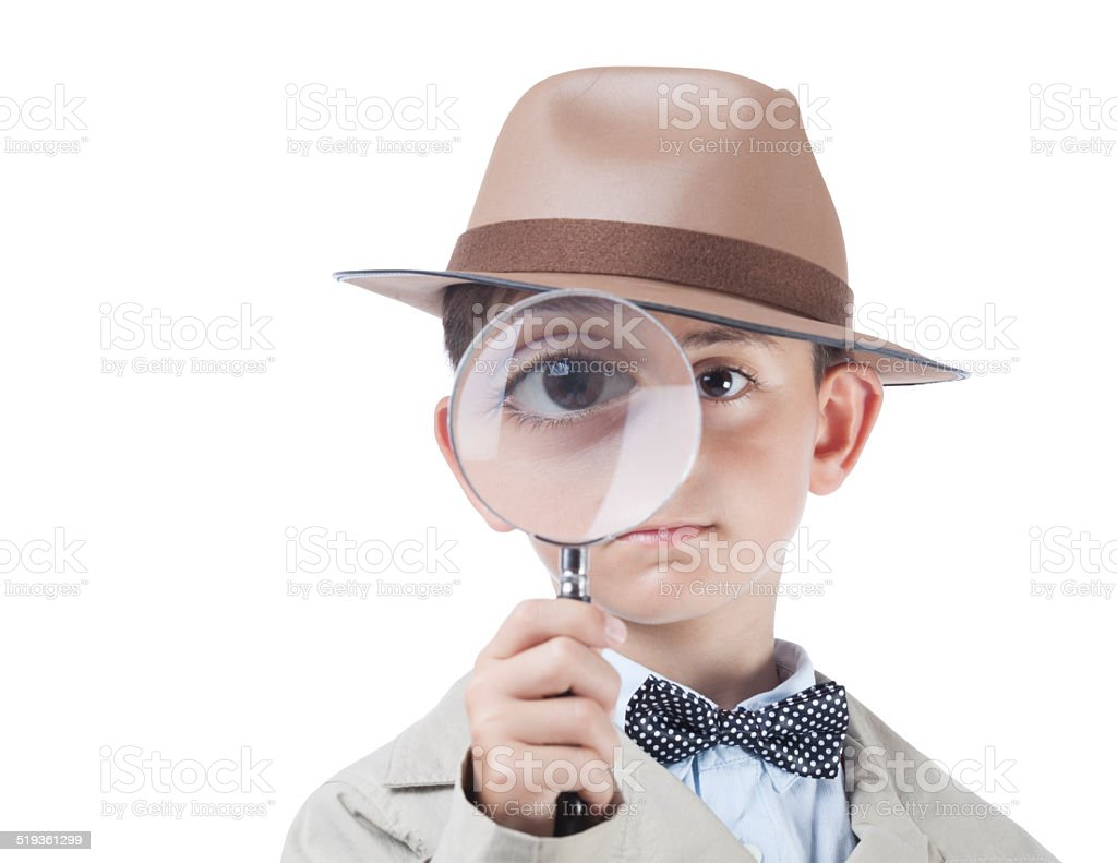 Little detective looking through magnifying glass with clipping path stock photo