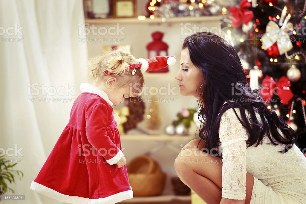 Little dissapointed girl with her mother at christmas time royalty-free stock photo