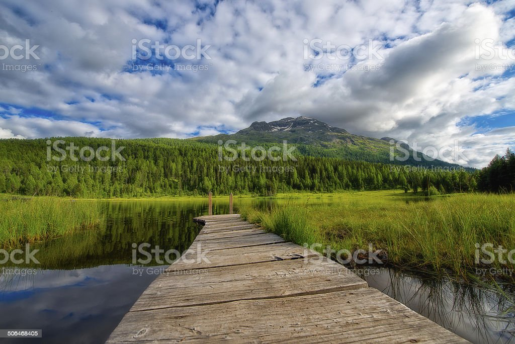 little dock on mountain lake stock photo
