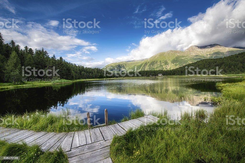 little dock on mountain lake royalty-free stock photo