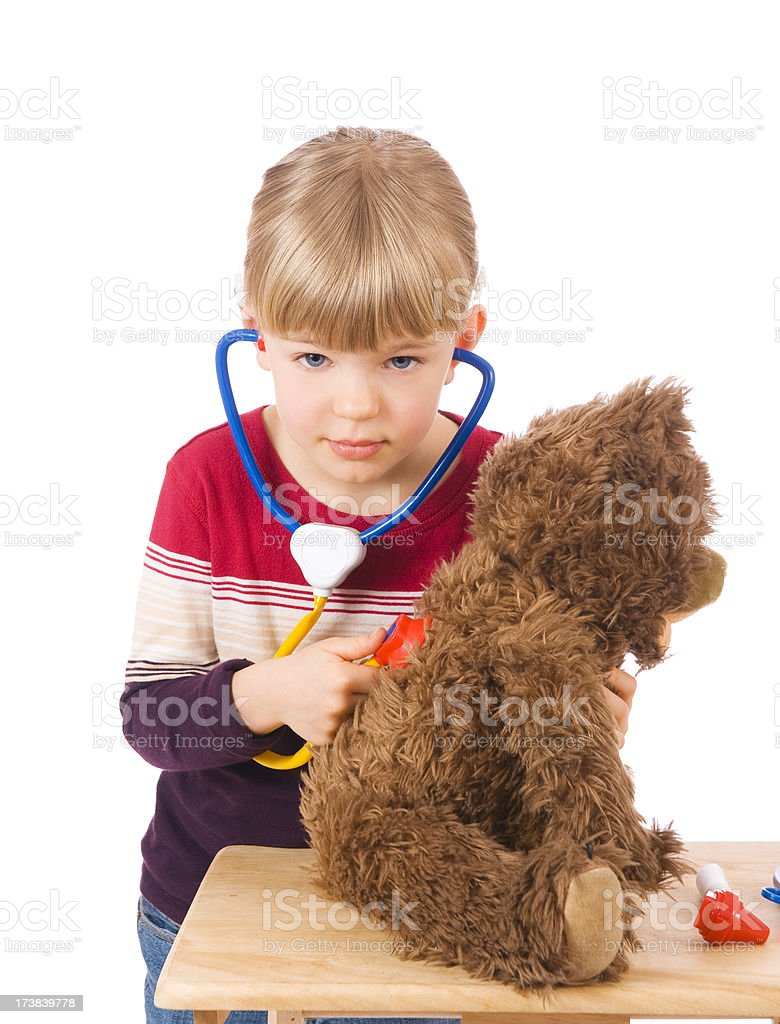 Little doctor with a teddy bear royalty-free stock photo