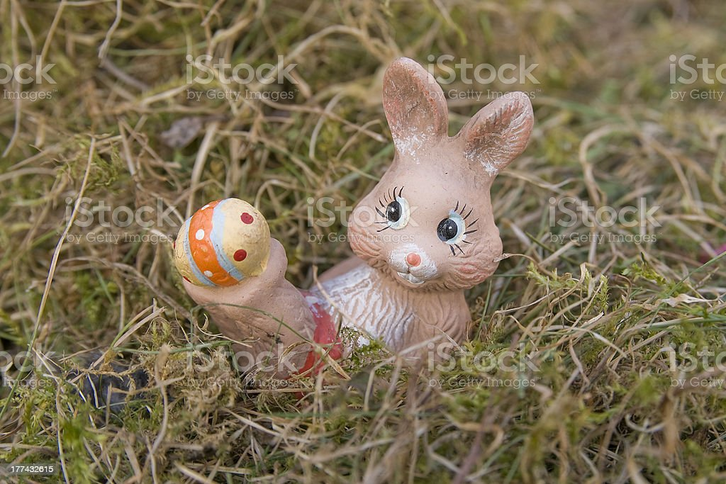 Little Easter bunnies in the hay stock photo