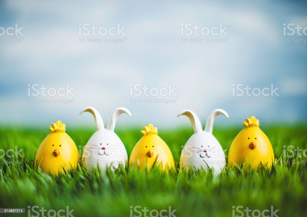 Little Easter critters sitting in grass with big blue sky