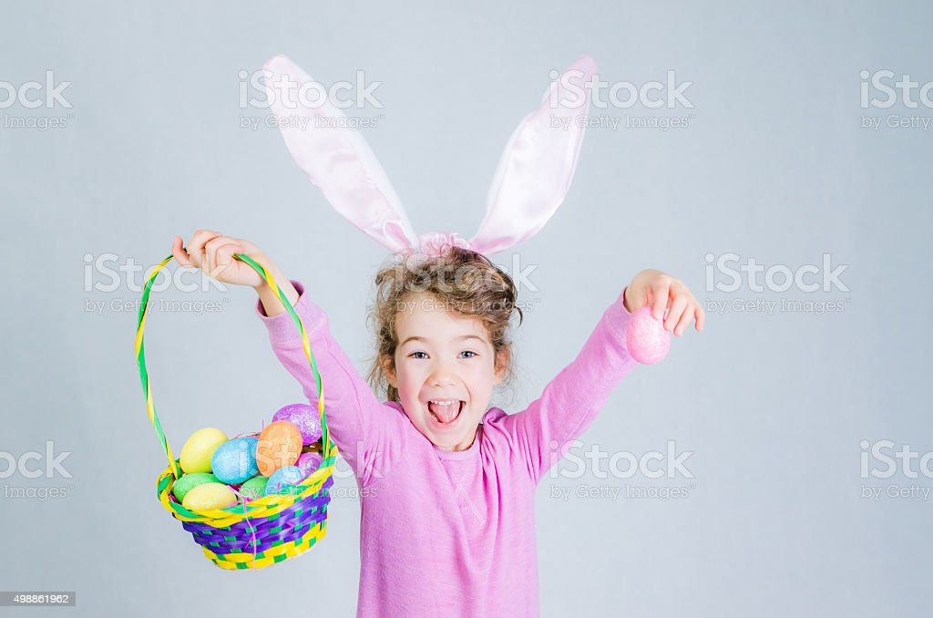 Little easter pink bunny girl stock photo