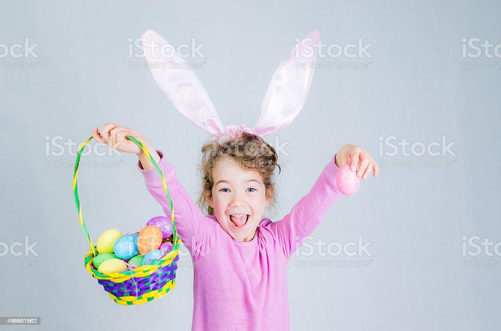 Little easter pink bunny girl stock photo