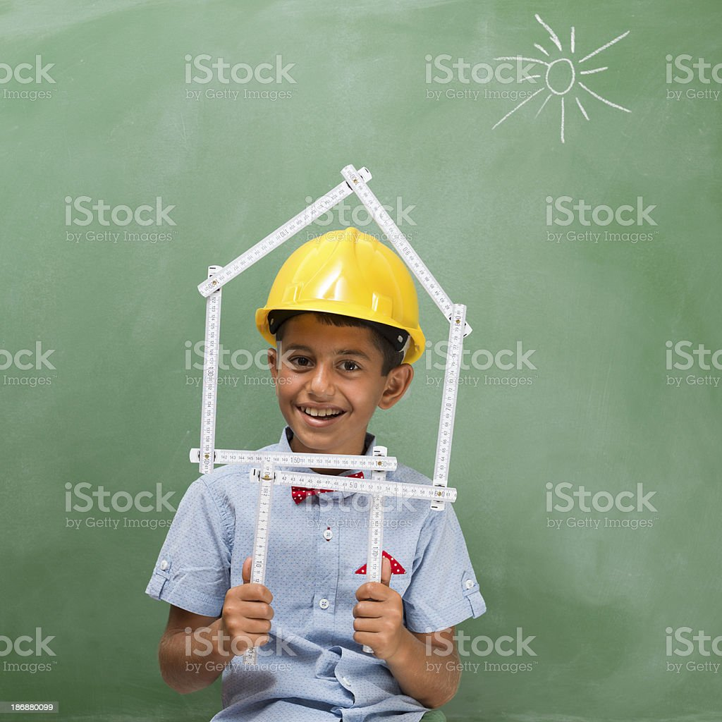 Little engineer with helmet and mustache holding blue prints royalty-free stock photo