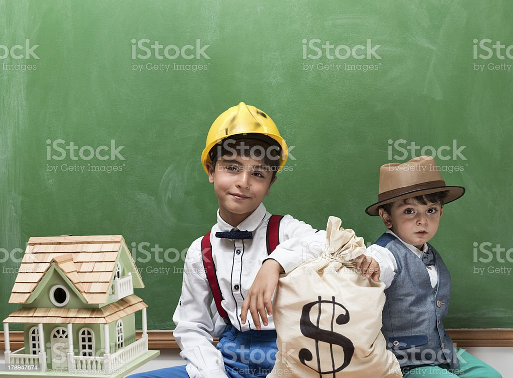 Little engineer with helmet designing a new house royalty-free stock photo