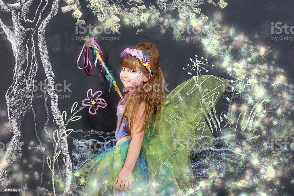 Little fairy in fantastic forest stock photo