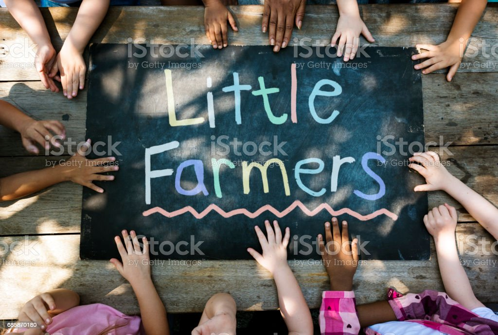 Little Farmers word is on the board stock photo
