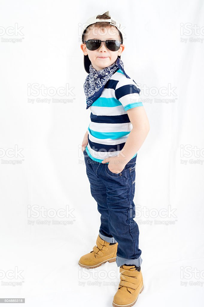 Little fashionable boy in stripped t-shirt and jeans stock photo