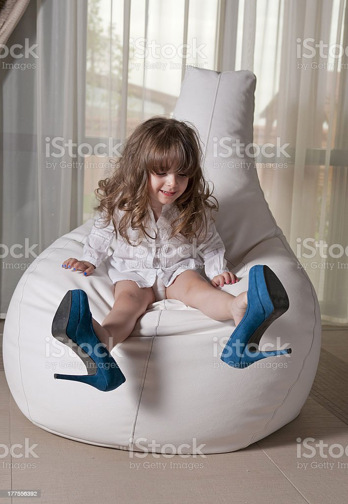 Little fashionista with blue high heeled shoes royalty-free stock photo
