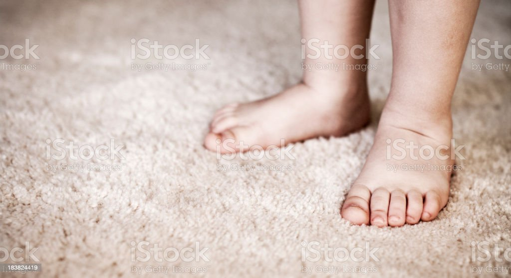 Little feet on carpet royalty-free stock photo
