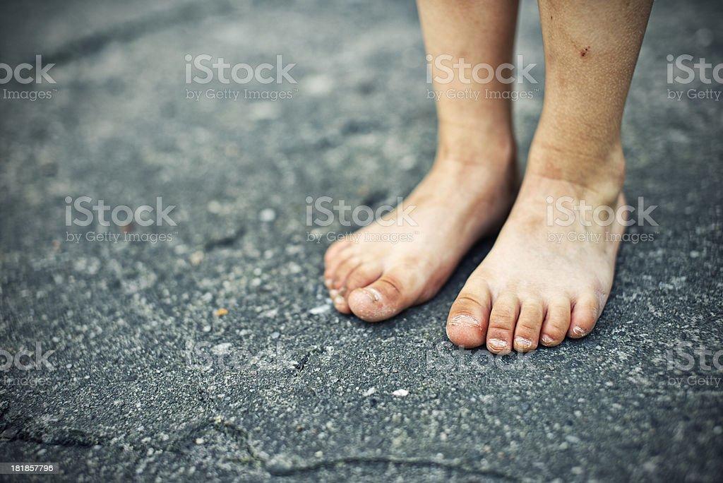 Little feet on concrete stock photo