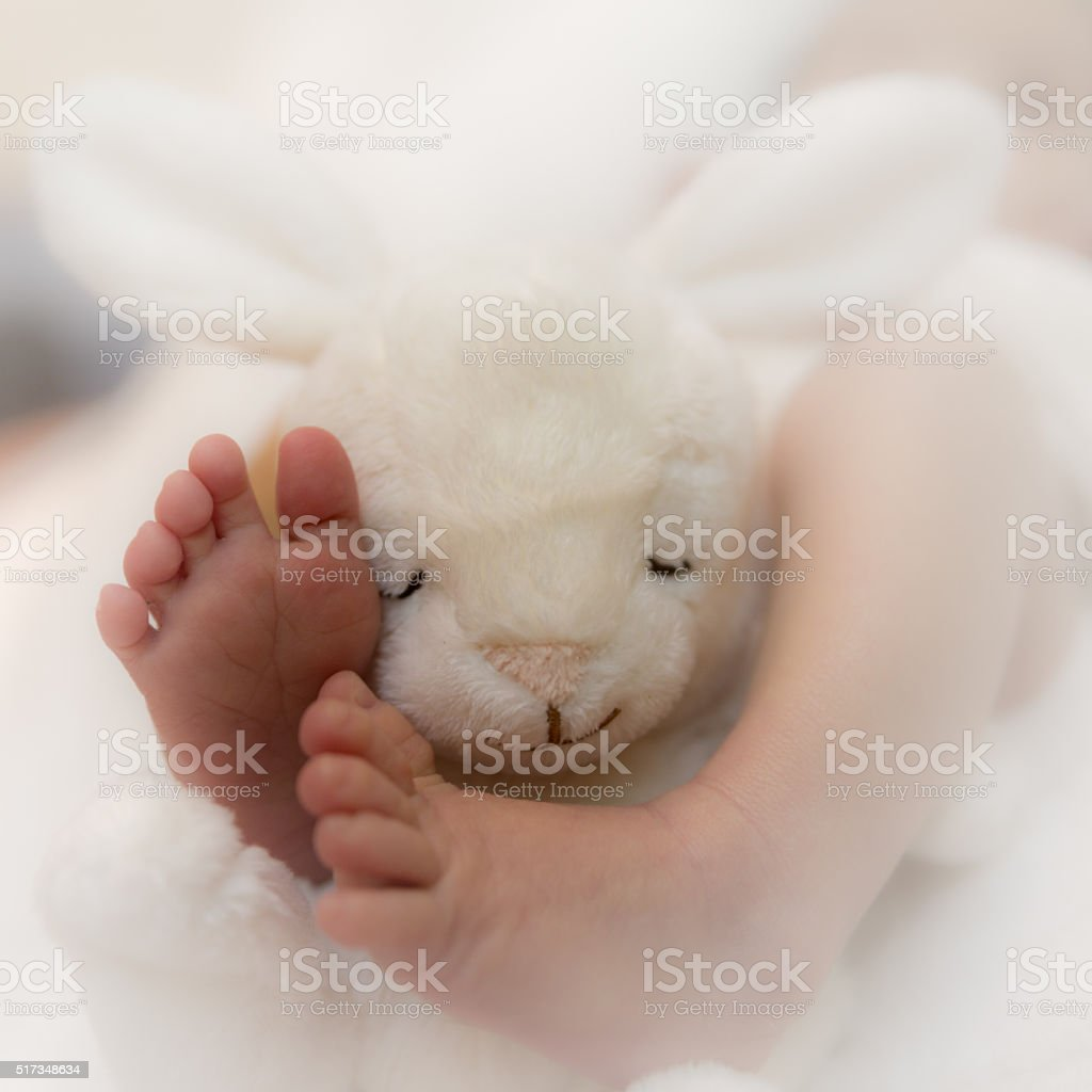 Little feets of a baby stock photo