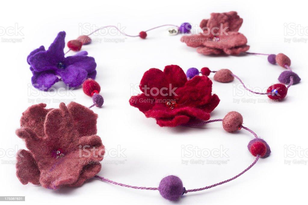Little felt flowers on a string stock photo