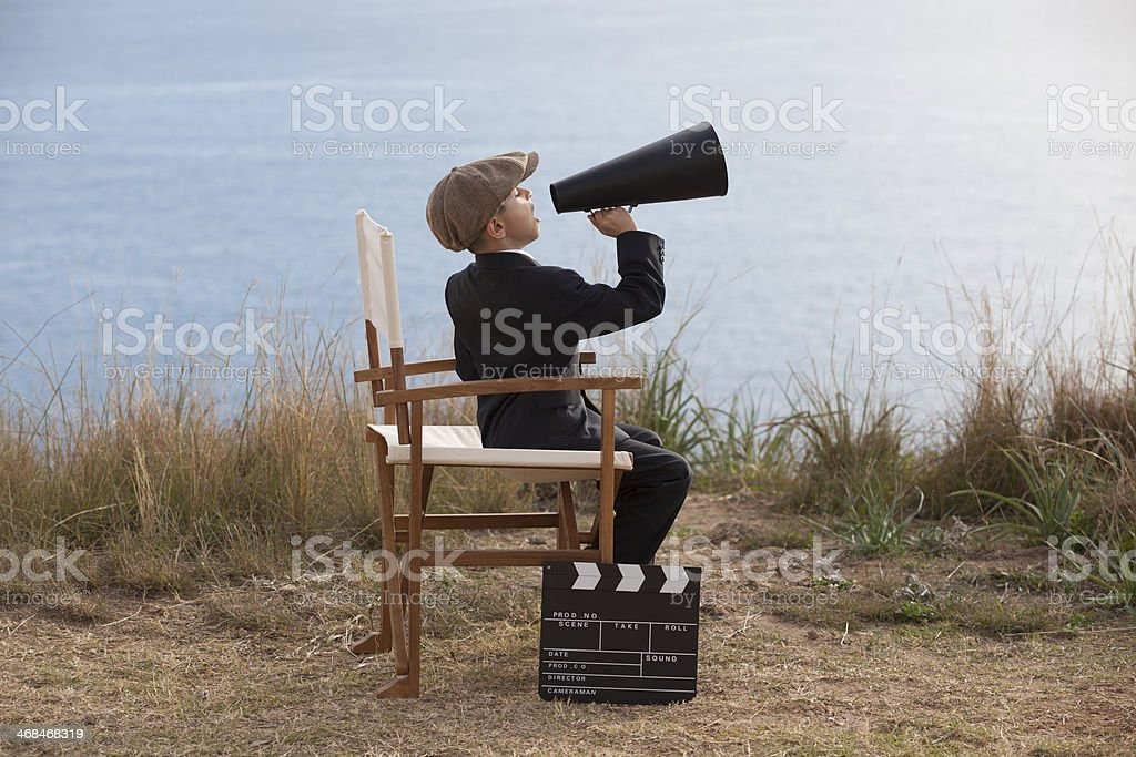 Little film director in action stock photo