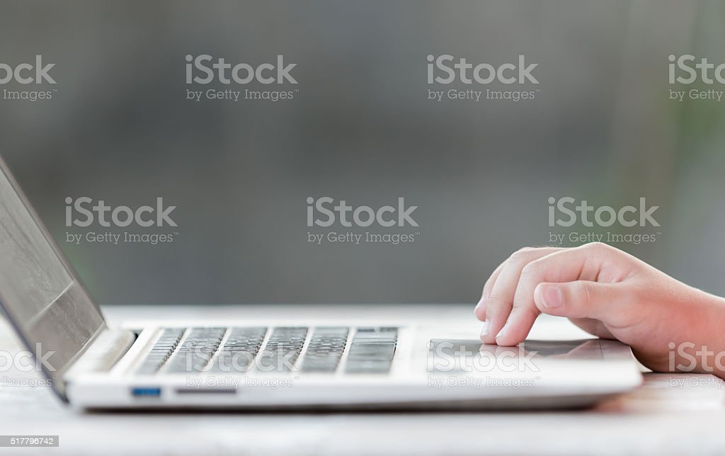 Little finger touch on touch pad notebook stock photo